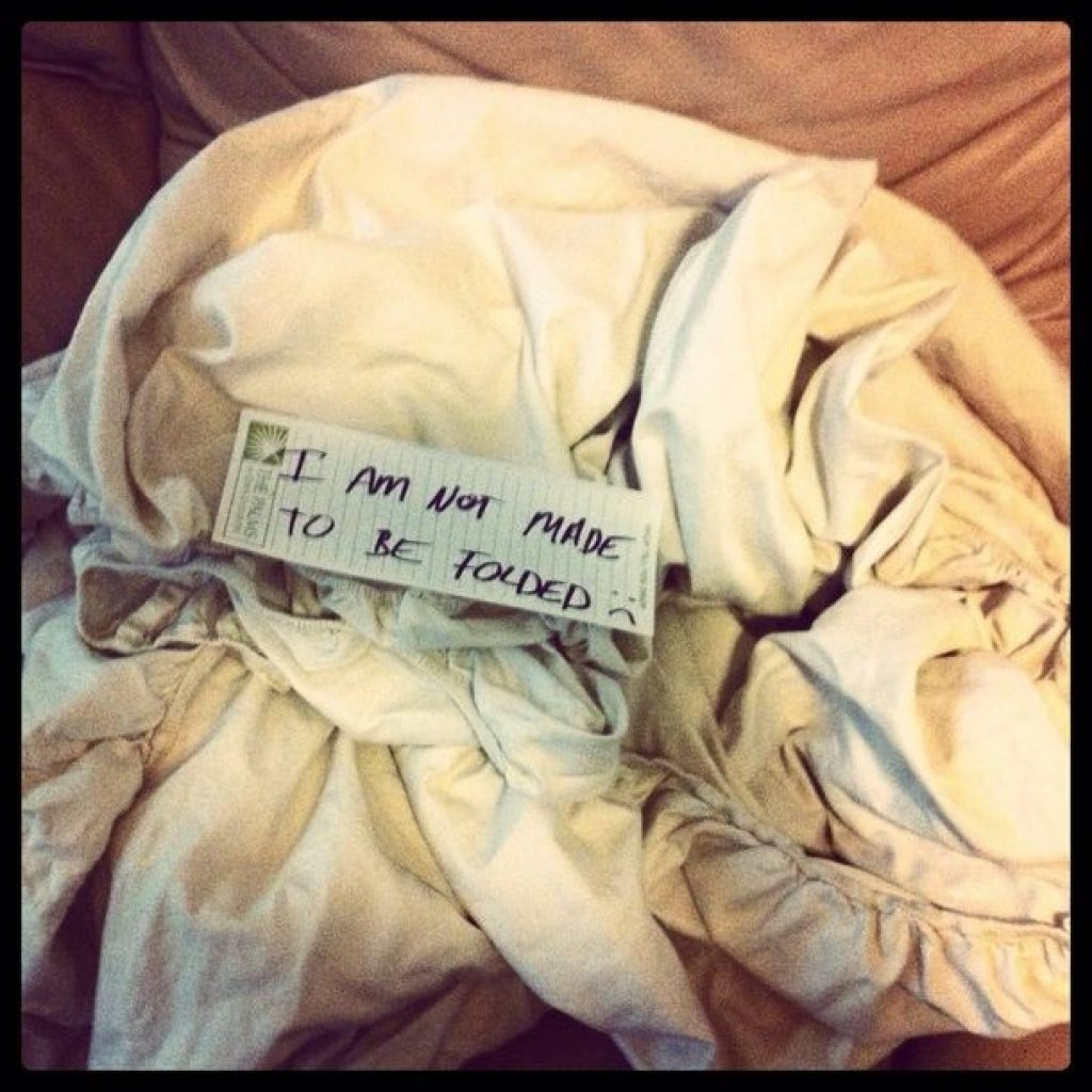 Husband left a note about not being able to fold fitted sheet