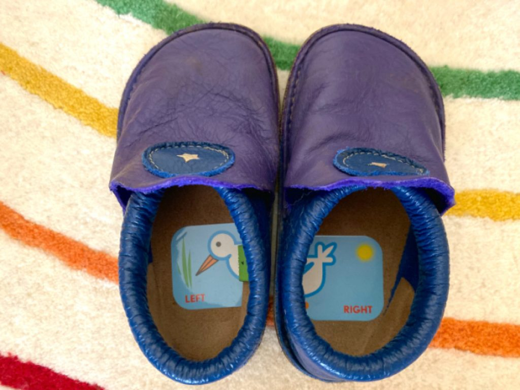 Baby shoes with stickers in them