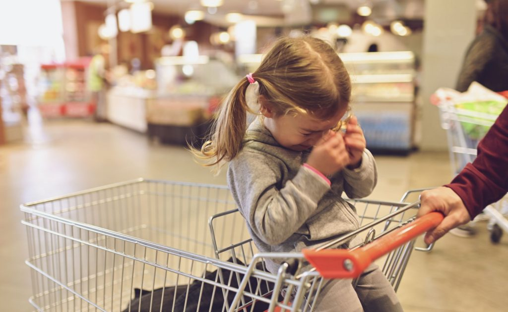 Little girl crying at grocery store