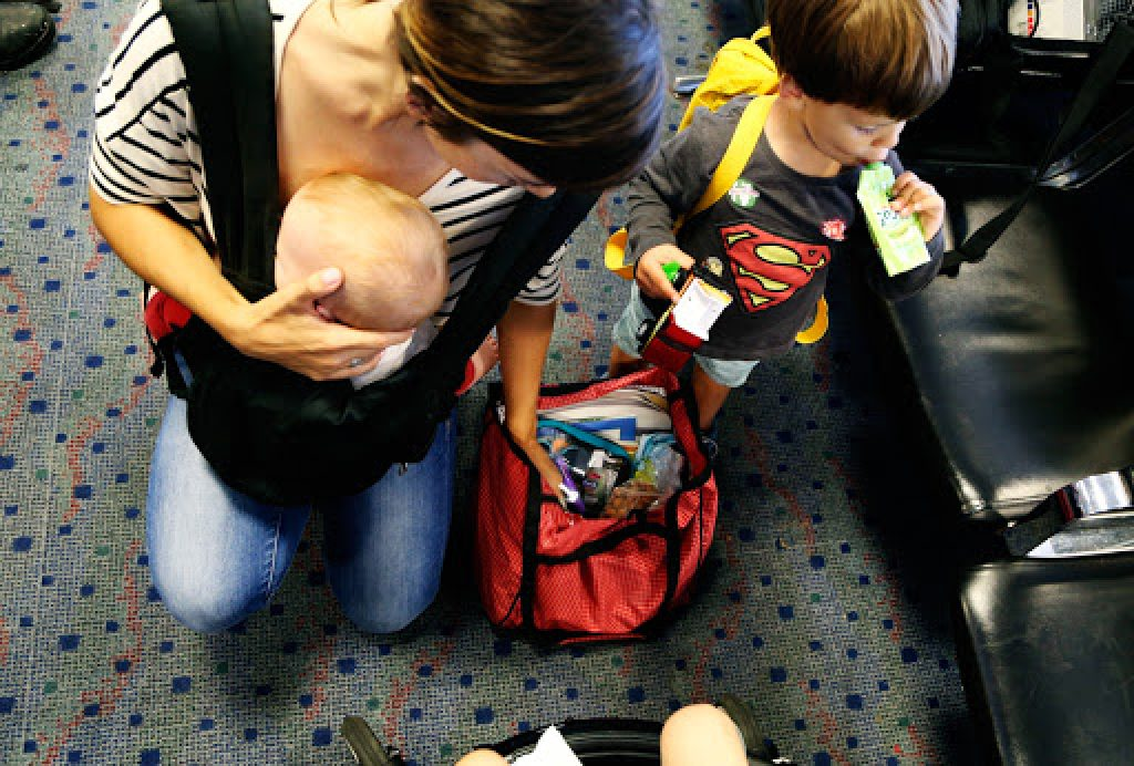 Mom with kids at airport