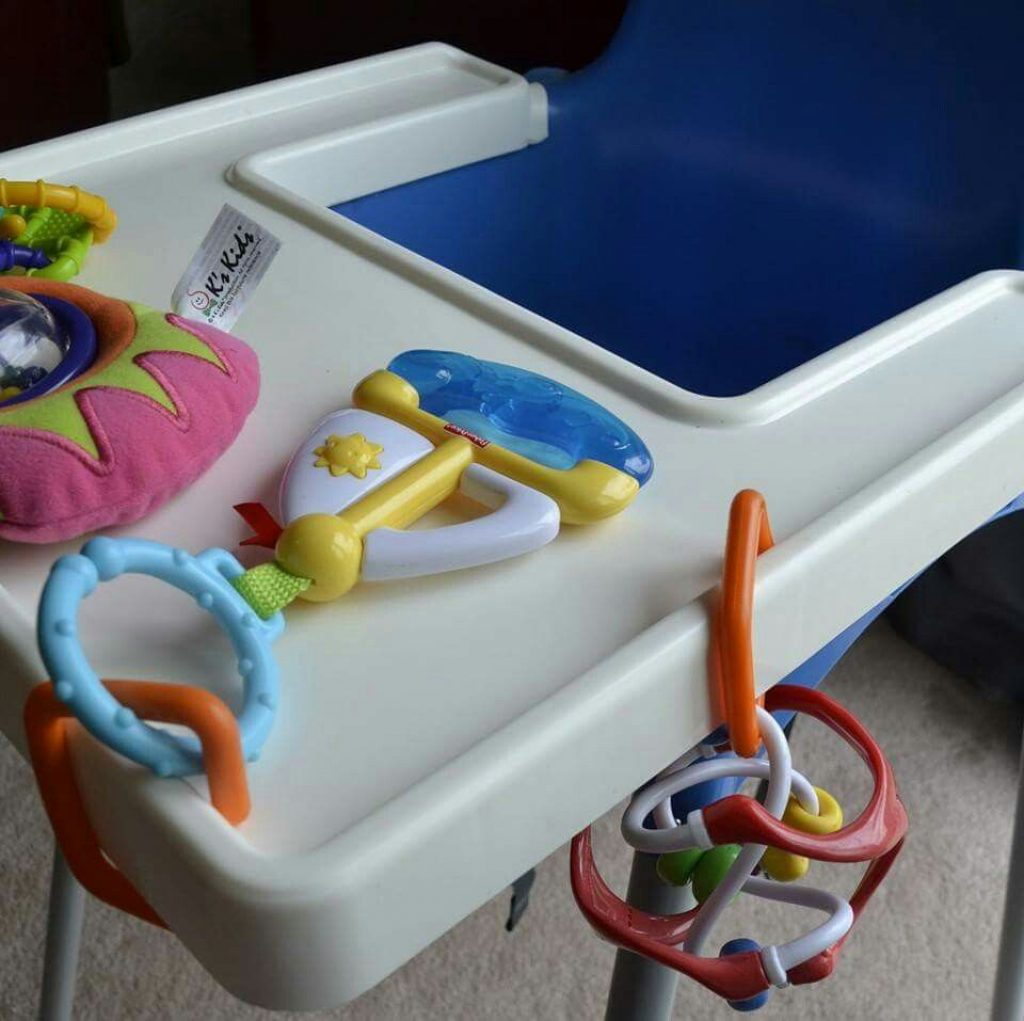 toys clipped to high chair