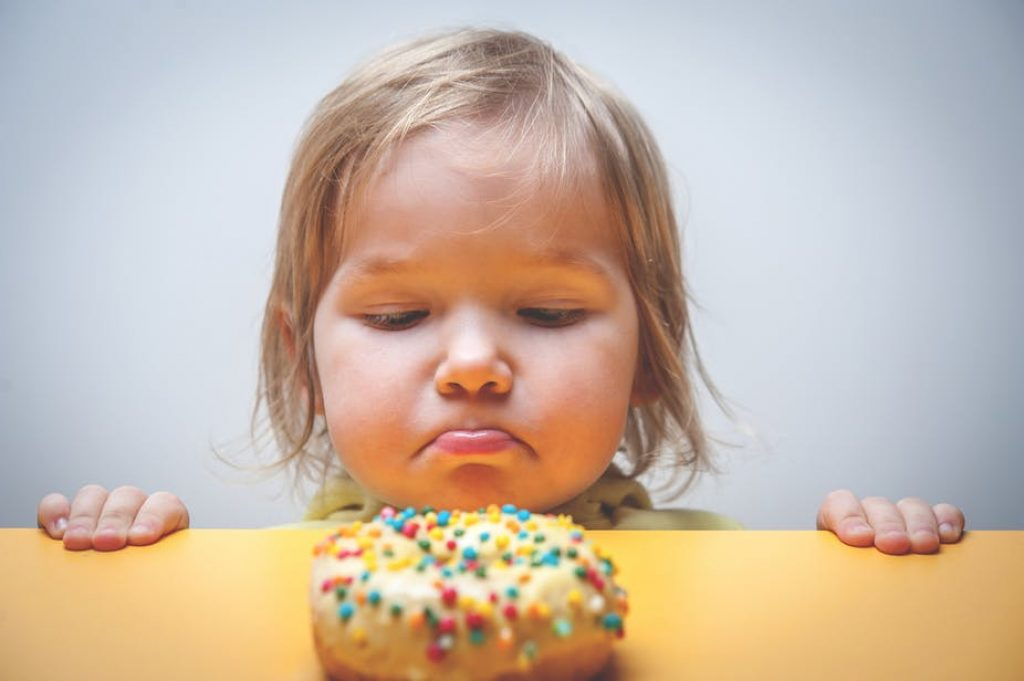 Child wants donut but can't have it